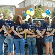 Members of Students for Professional Nursing posing prior to the Homecoming parade