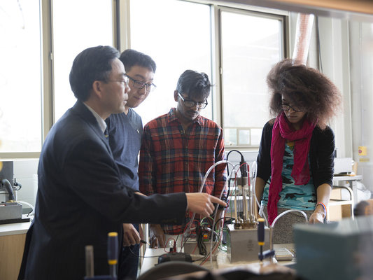 Students in lab with professor