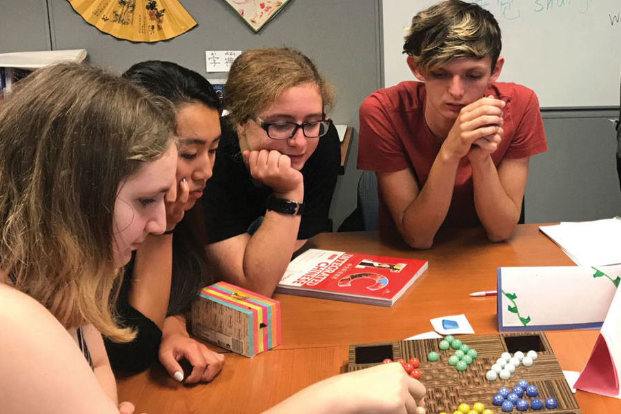 Students in the Chinese Course Play a Chinese Board Game