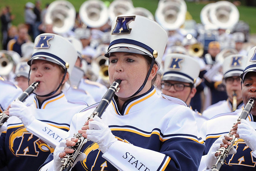 Members of the Kent State University Marching Band make their way toward Main Street during the start of the 2016 Homecoming Parade.