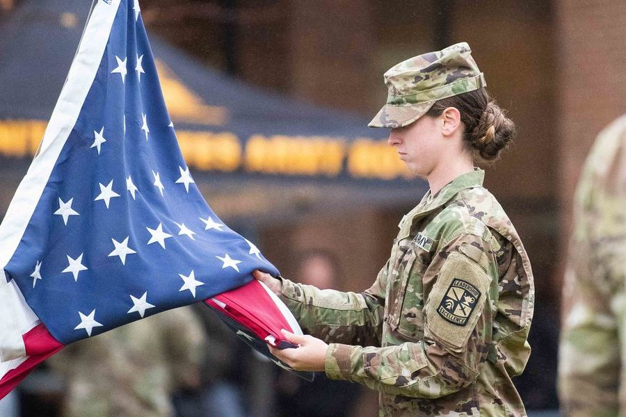 A joint color guard from Kent State's Army and Air Force ROTC programs conducts a flag-raising ceremony