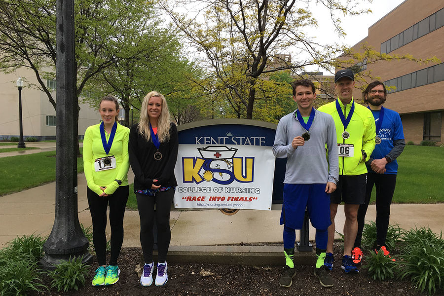 The 2017 Race into Finals men's and women's top finishers pose with their medals outside Henderson Hall. From left: Kellie Janus, Jammie Rhoads, Zach Morris, Eric Asp, and Noah Gurney.