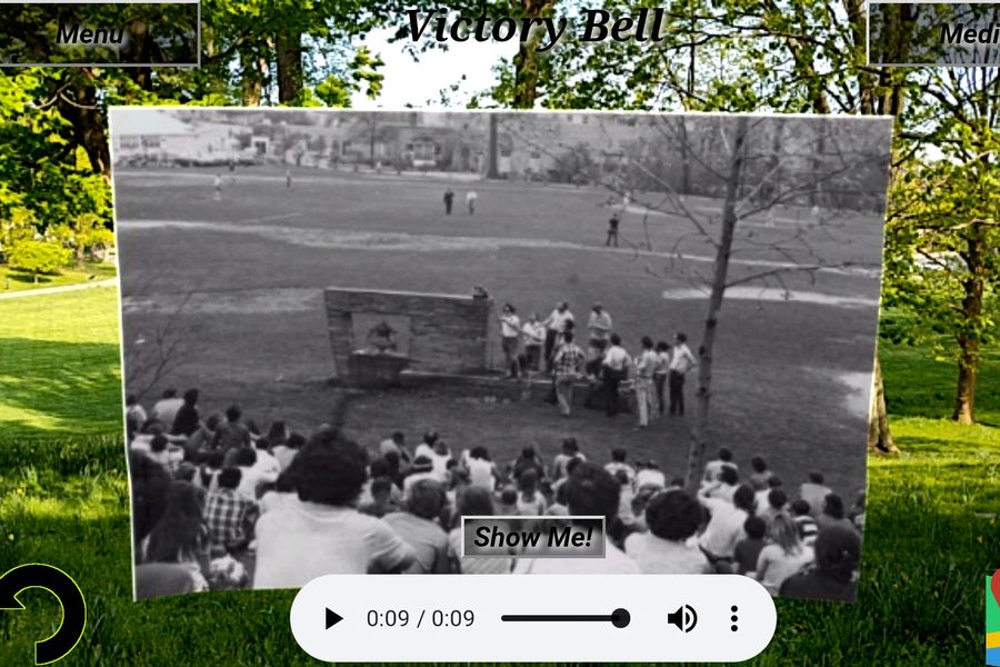 Shown is the augmented view of the Victory Bell on the Kent State University campus as it would have looked on May 1, 1970.