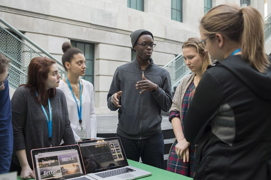 Students discuss their project during the 2016 Fashion/Tech Hackathon at Kent State University's Fashions School.