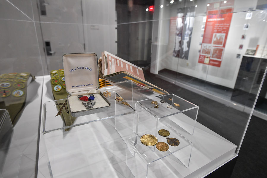 """Personal items of Bill Schroeder, including his Eagle Scout Award and Boy Scout sash showing his merit badges, are on display in a new exhibition at Kent State University's May 4 Visitors Center called """"Bill: An All-American Boy."""""""