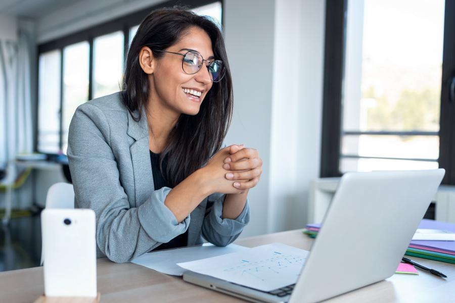 A student enjoys her online class.