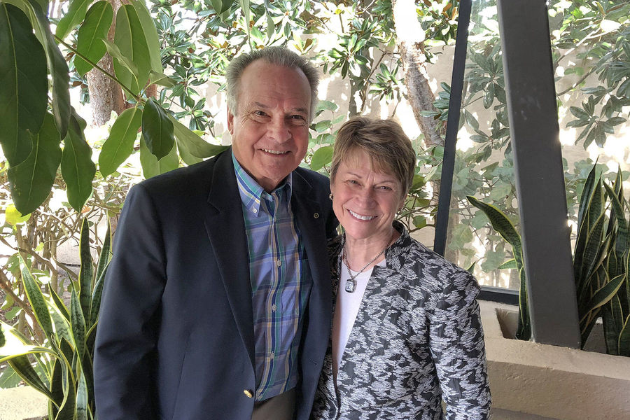 George R. Newkome, Ph.D., a two-time Kent State University alumnus, smiles with Kent State President Beverly J. Warren.