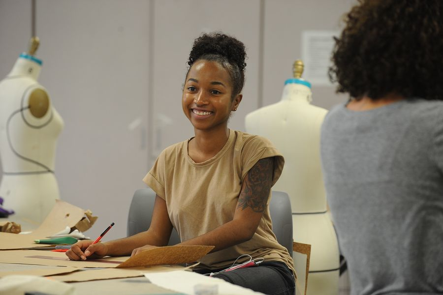 A student in Kent State University's Fashion School works on a project in a design classroom. A new partnership between Kent State and Akron Public Schools will allow Akron students to immerse themselves in innovative design areas including fashion.