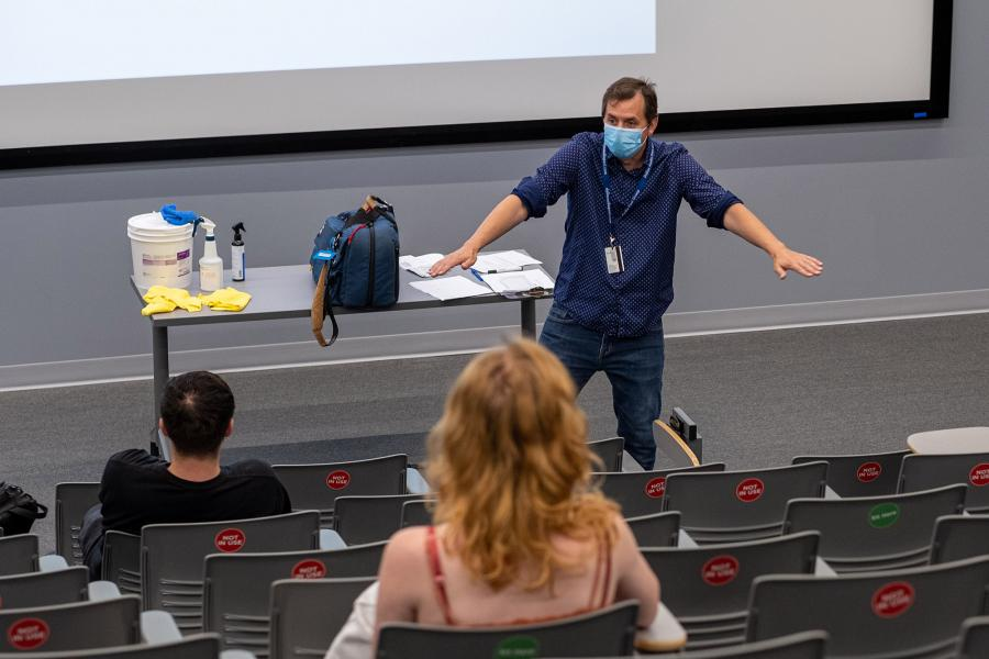 Kent State University Assistant Professor Scott Hallgren from the School of Media and Journalism teaches a class in an auditorium during the 2020 Fall Semester.