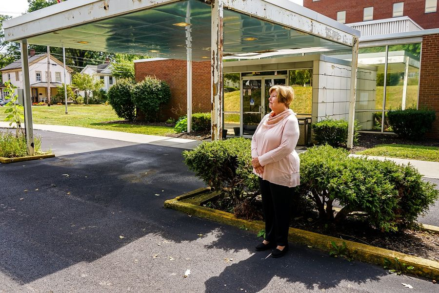 Kent State University alumna Pat Gless reflects on May 4, 1970, near what was then the ambulance bay of the old Ravenna hospital.
