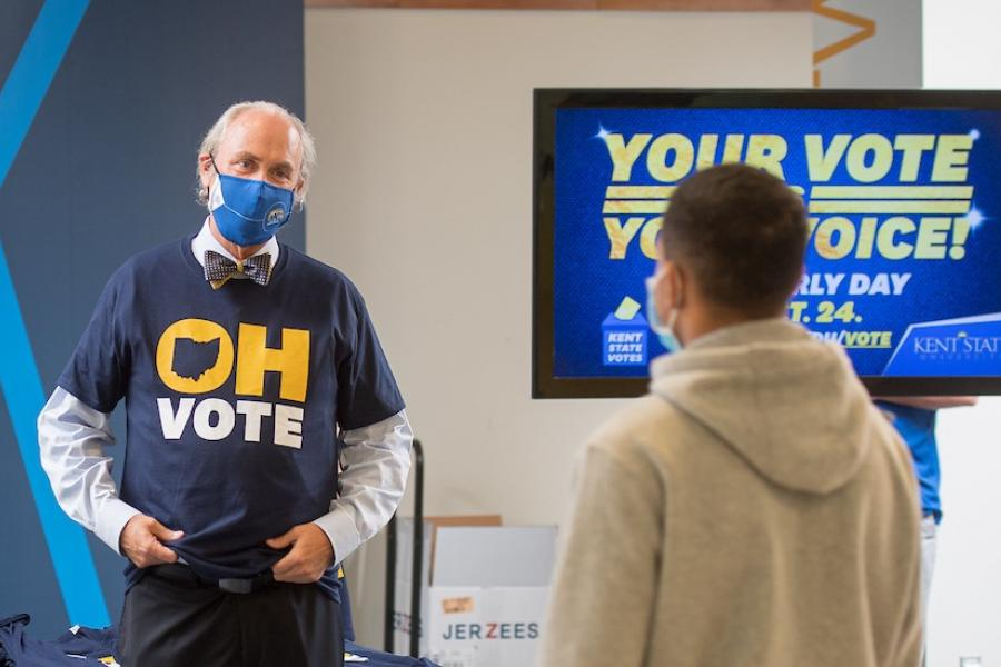 Kent State University President Todd Diacon passes out T-shirts and encourages students to exercise their right to vote on Election Day.