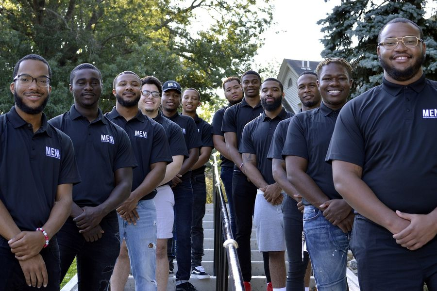 President Khalil Looney (far right) and some fellow members of Kent State University's Male Empowerment Network (M.E.N.) pose for a photo. The Steve and Marjorie Harvey Foundation has pledged a $10,000 matching gift for Giving Tuesday to the M.E.N. Fund.