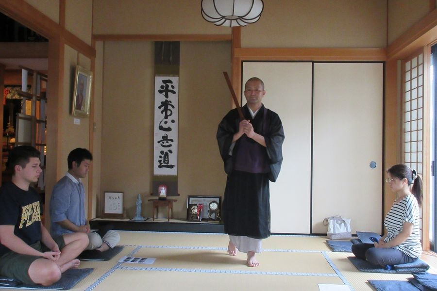 Kent State University graduate student Cody Ruiz (far left) practices zazen (seated meditation) at a Buddhist temple.