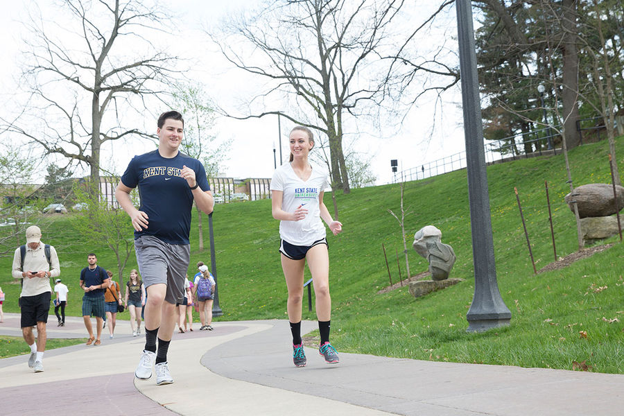 Kent State students get some exercise by running on the Lefton Esplanade on campus.