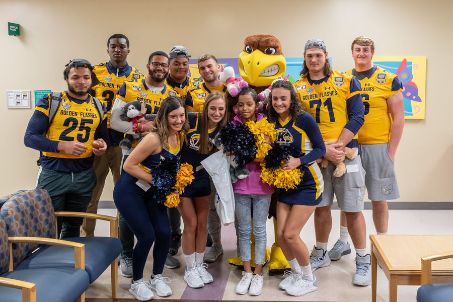 Members of Kent State football, dance, cheer and the marching band visited kids at Children