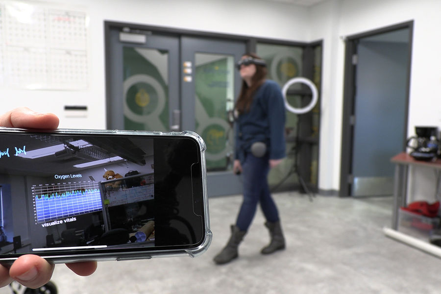 Caitlyn Lenhoff, a masters student in Computer Science, demonstrates the ATR_FLUX augmented reality user interface