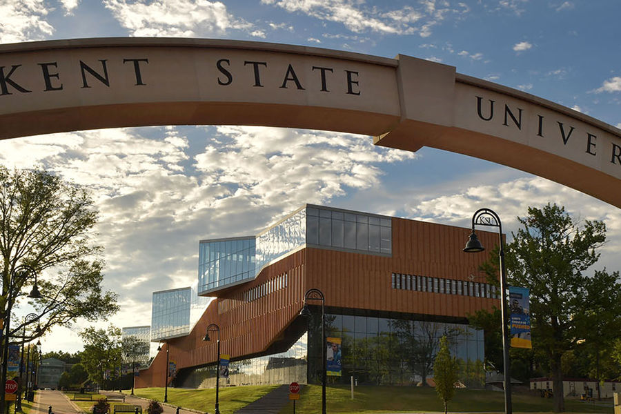 Kent State University arch, in front of the College of Architecture and Environmental Design on a sunny day