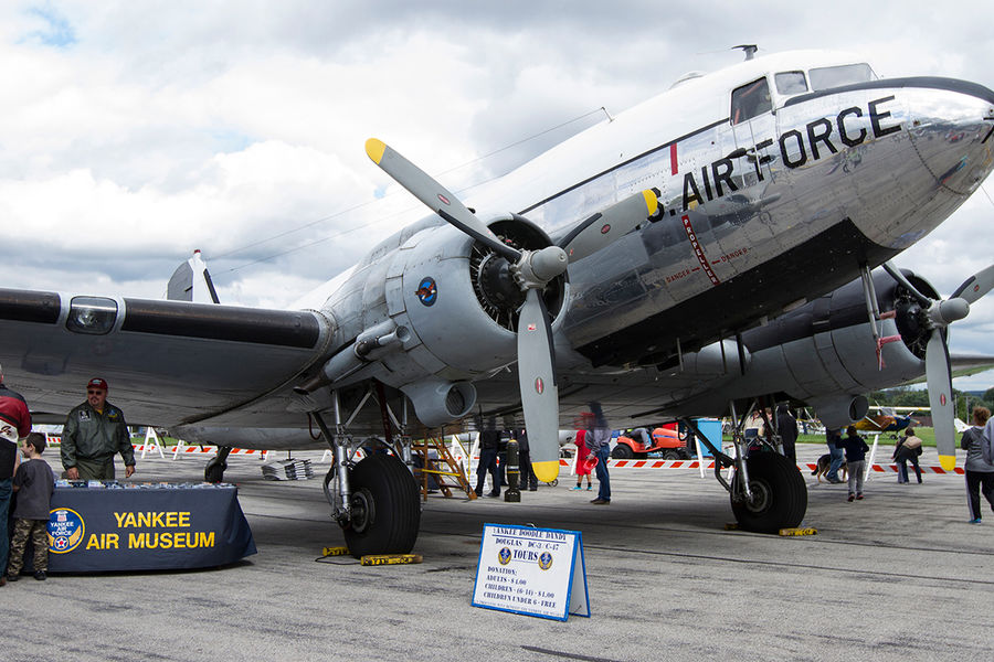 A Douglas DC-3/C-47 cargo plane sits on the tarmac at the Kent State University Airport during the 2014   Aviation Heritage Fair. The plane is owned by the Yankee Air Museum and was open for tours.