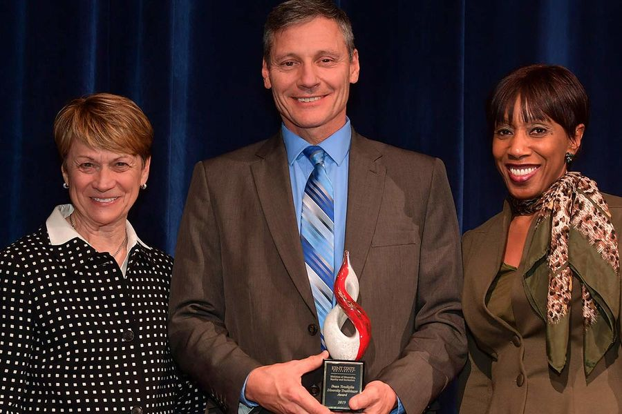 Kent State President Beverly J. Warren and Vice President Alfreda Brown give the Diversity Trailblazer Award to Dean Tondiglia, director of public safety and Kent State police chief.