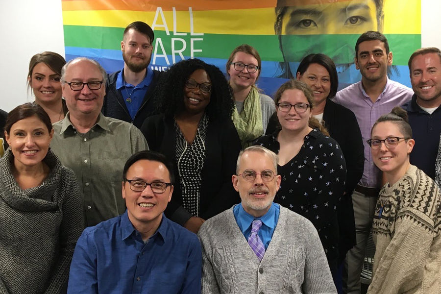 Stuart Chen-Hayes, '94, and Lance Chen-Hayes at the LGBTQ+ Center with Luncheon Guests
