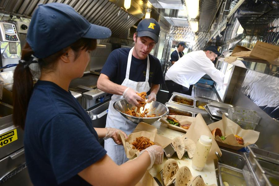 Students prepare food in the Fork in the Road food truck.