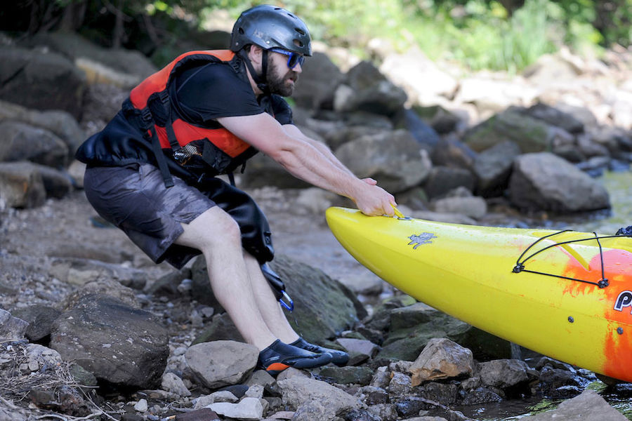 Kayaks line the shore of the Cuyahoga River in Kent, Ohio, as part of Crooked River Adventures, which is run by the Kent State Student Recreation and Wellness Center.