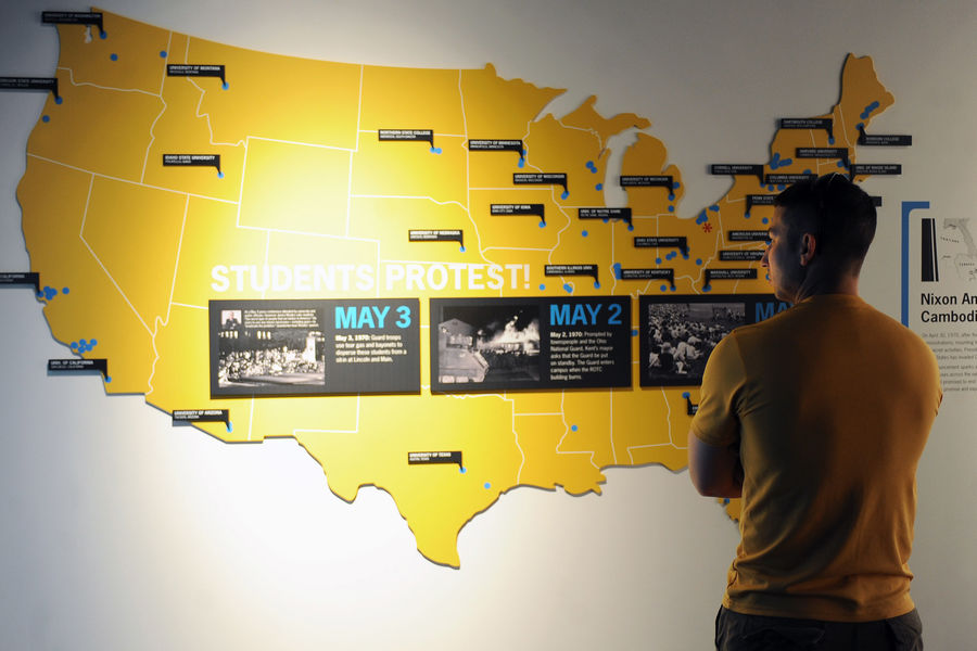 A visitor learns about the events surrounding May 4, 1970 while visiting the May 4 Visitors Center