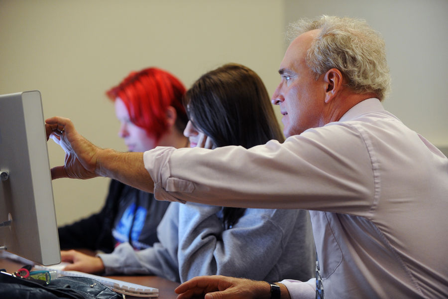 A faculty member works with a digital sciences major during a course.
