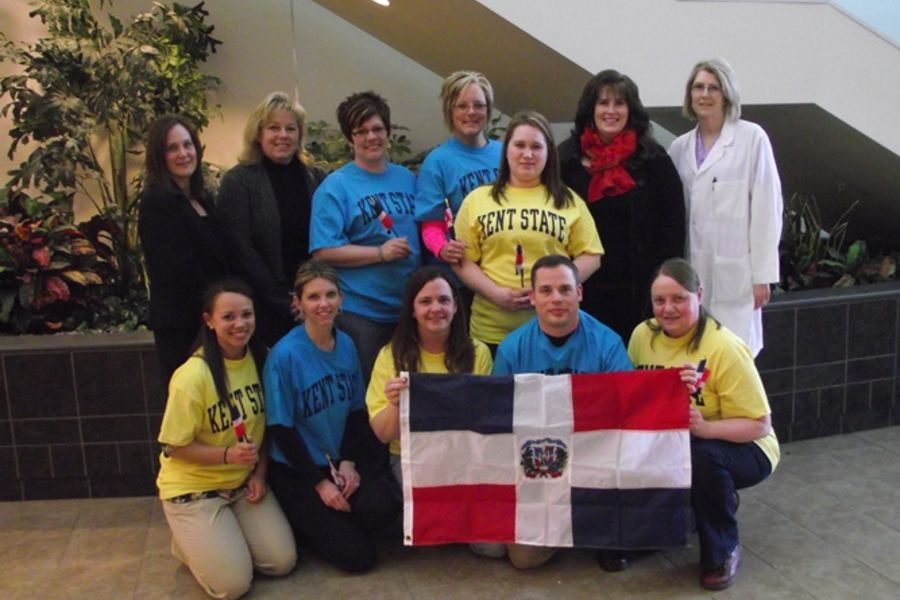 Ashtabula nursing students and faculty hold a Dominican Republic flag