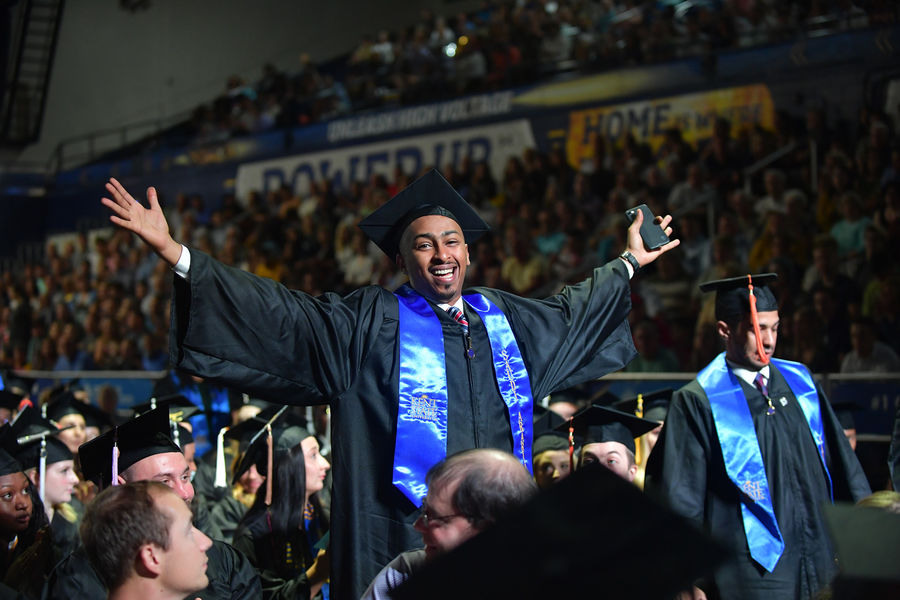 Finish Line Feeling.  A Kent State student embraces the moment after receiving his degree during the Aug. 17 undergraduate commencement ceremony at the Memorial Athletic and Convocation (MAC) Center.