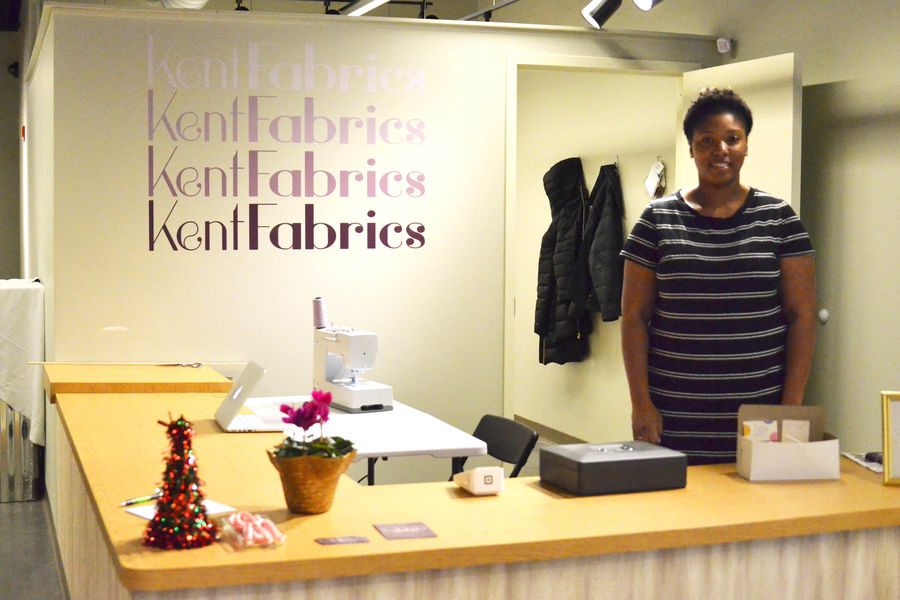 Student Symone Baskerville Standing inside new Kent Fabrics storefront