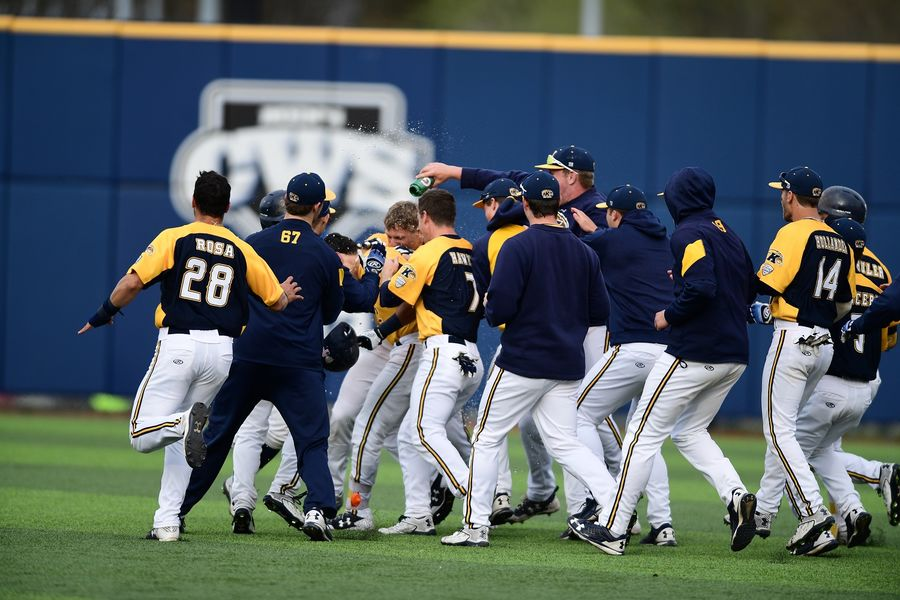 The Kent State baseball team celebrates a walk-off win over Toledo earlier this season at Schoonover Stadium. For the second straight year, the Kent State team has been crowned the outright Mid-American Conference regular season champions.