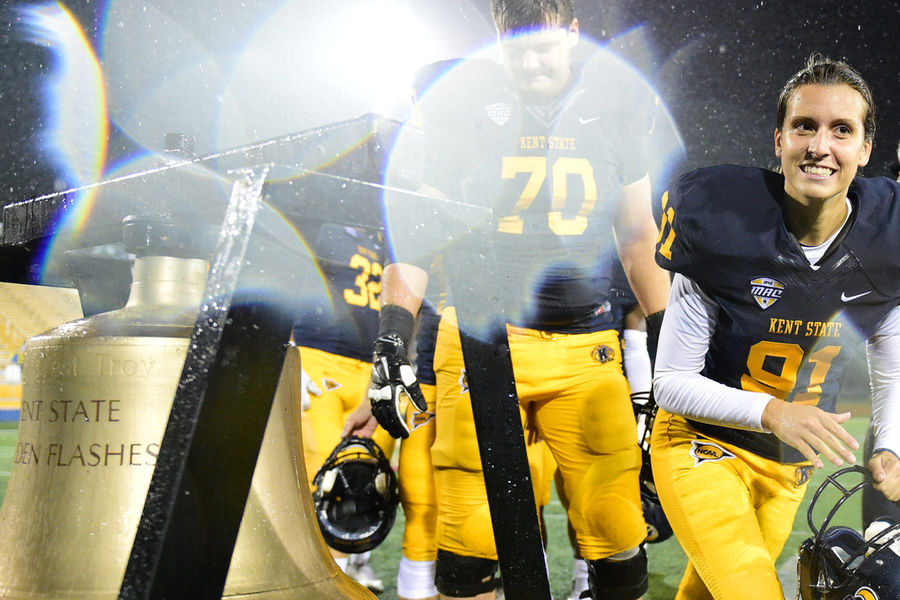 Kent State kicker April Goss rings the victory bell following the Golden Flashes' 45-13 win over Delaware State.