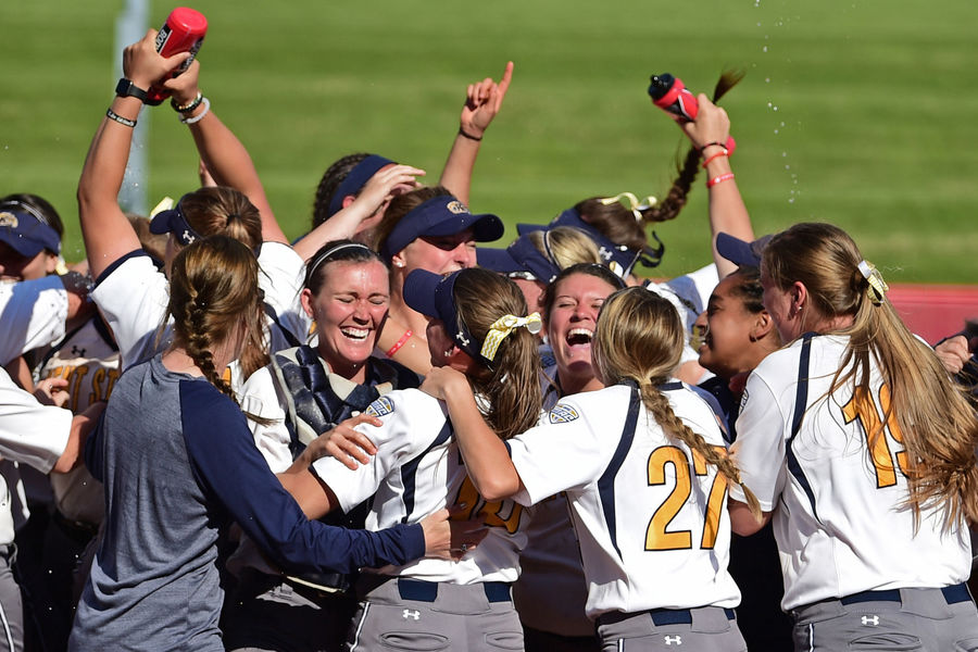 The Kent State softball team celebrates on the field following its 3-0 victory over Ohio to win the 2017 MAC Softball Tournament Championship.