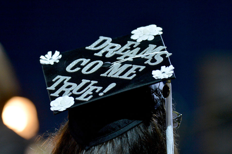 A Kent State graduate shows her pride during the Fall 2015 Commencement ceremony.