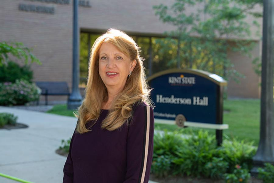 Photo of Interim Dean Denice Sheehan outside Henderson Hall