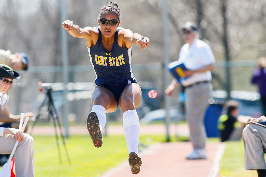 Dior Delophont, senior fashion design major from France, competes in the long jump during a Kent State track meet.