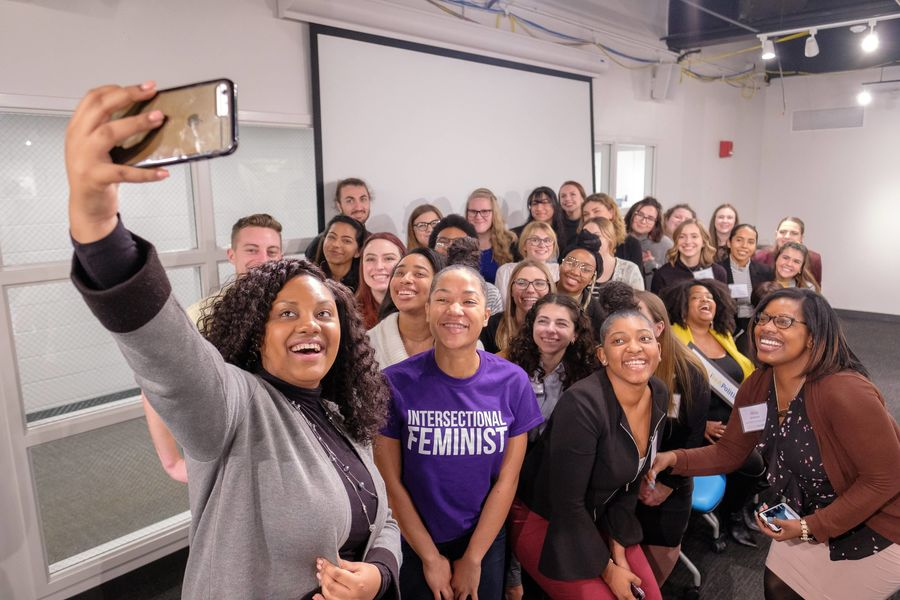 Electher group selfie with students and staff