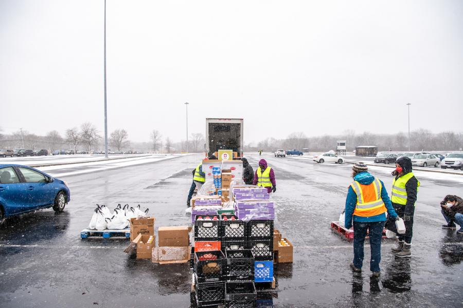 Volunteers from Kent State, the Akron-Canton Regional Foodbank and the National Guard assisted more than 200 families during the snowy  drive-through food distribution event on Wednesday at Dix Stadium.