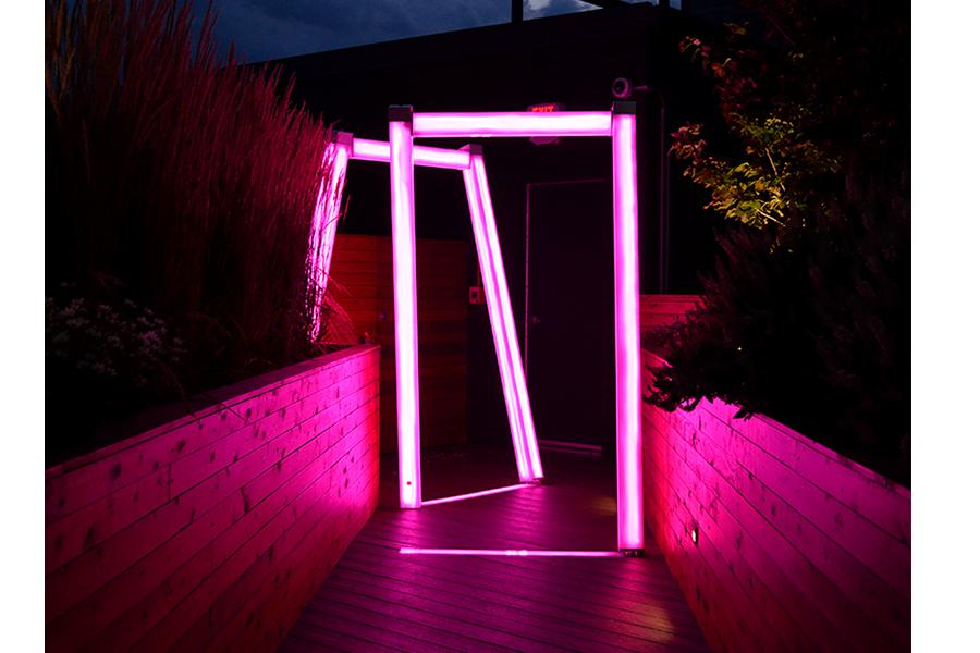 Truss by Scott Goss. A color-changing illuminated sculpture that is made of tubing installed in a rooftop garden in Cleveland.