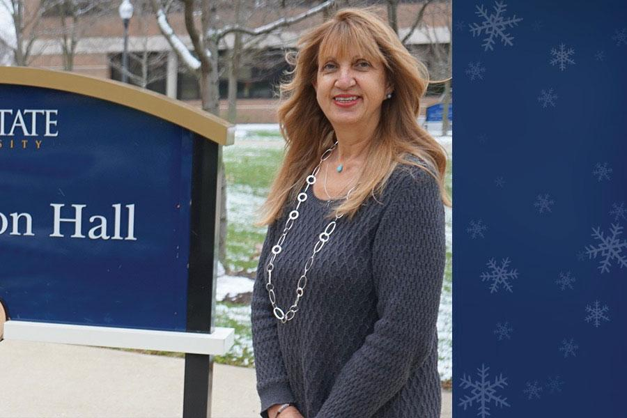 Interim Dean Denice Sheehan poses for a photo outside Henderson Hall.
