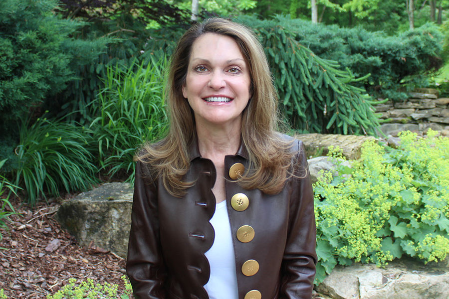 Dr. Amy Petrinec outside in nature