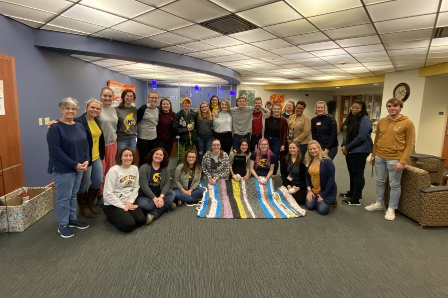 Honors College Students and Staff Pose at Mat Making Event