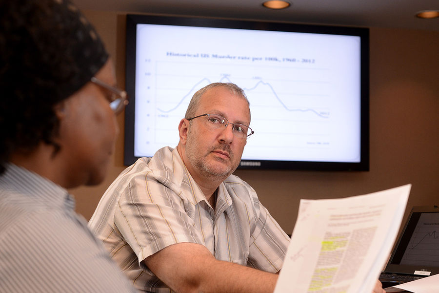 Eric Jefferis, an associate professor of social and behavioral sciences in the College of Public Health, teaches a Ph.D.-level class in Lowry Hall. Jefferis has been selected as Kent State's Scholar of the Month.