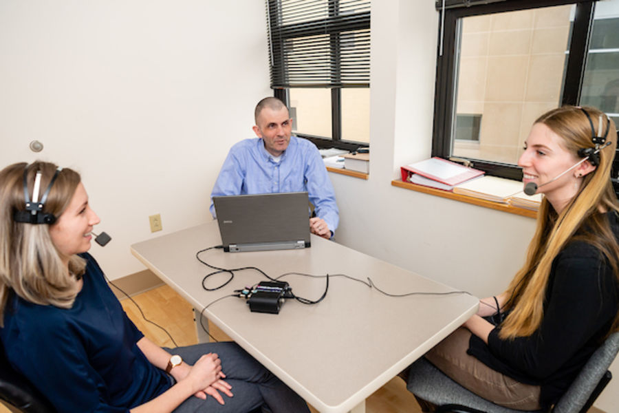 Kent State professor John Gunstad and his research assistants Hanna Schmetzer and Victoria Sanborn demonstrate using the voice pattern technology that is part of his Alzheimer