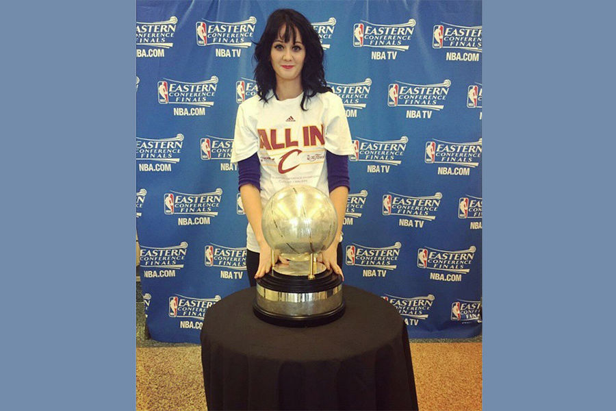 image of Katrina Hall with a cavs championship trophy