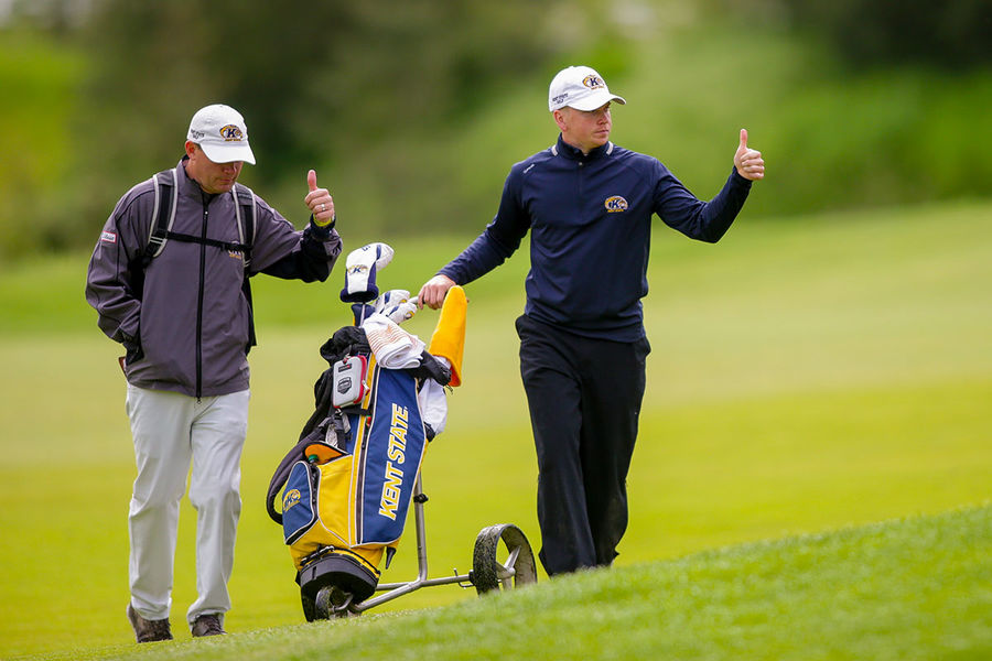 Kent State associate head coach Jon Mills (left) and sophomore Gisli Sveinbergsson (right) both give a thumbs-up after a strong hole. The Kent State men's golf team finished second at the NCAA Washington Regional and advances to the NCAA Championship.