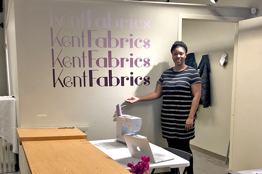 Symone Baskerville Poses in Kent Fabrics During the Grand Opening