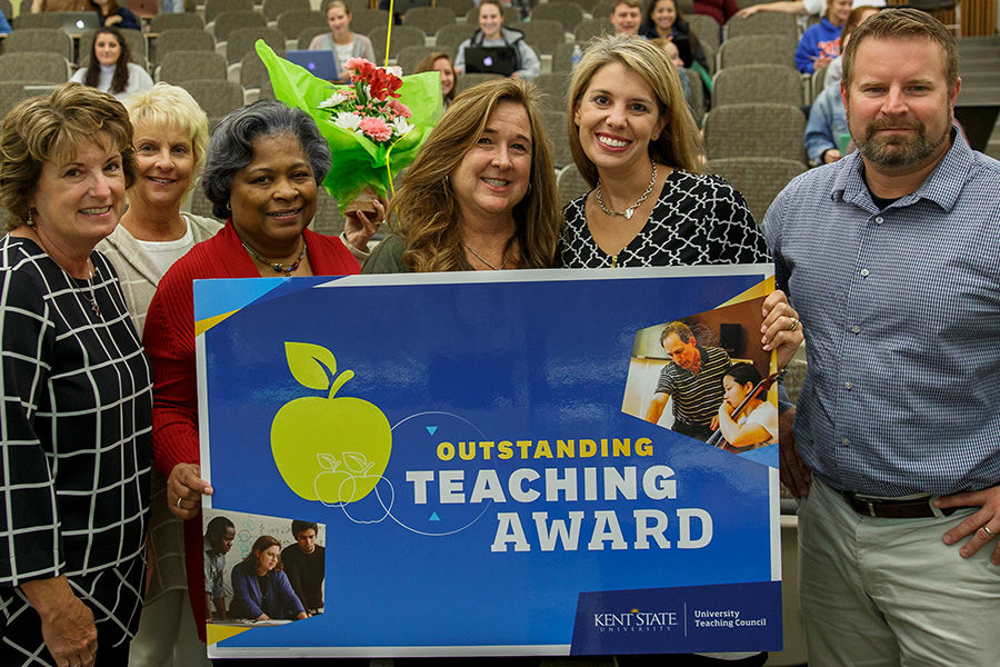Mary Kutchin (third from right) was surprised to learn she was selected as one of three 2018 Outstanding Teaching Award Recipients during her Friday morning class. Mary is joined by (from left) Mary Bacha, MSN, RN, Tracey Motter, DNP, RN, Dean Barbara Bro