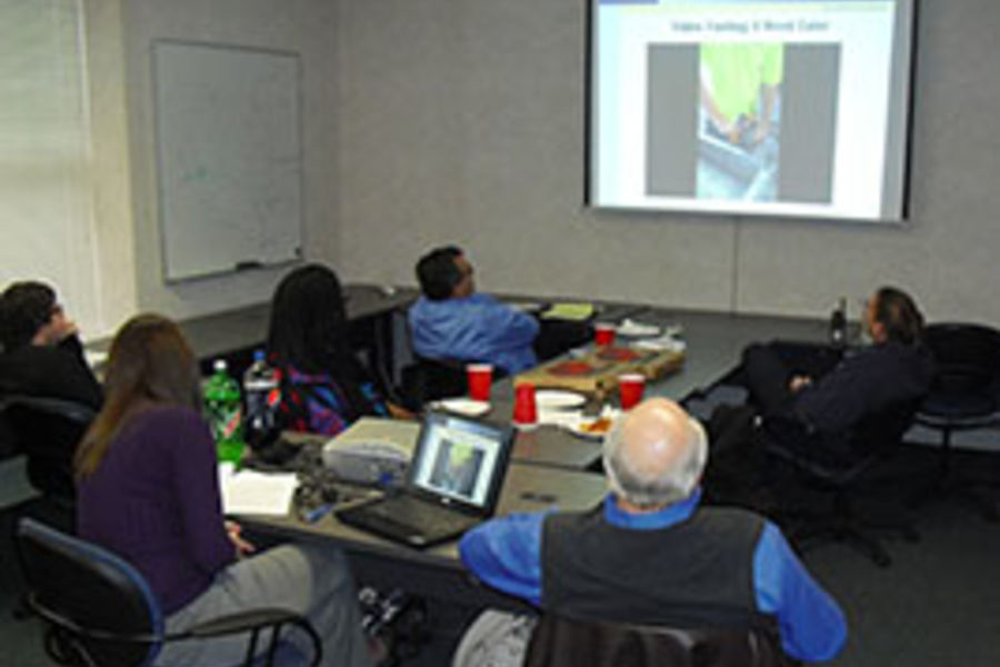 Kent State University students and employees review safety videos created by students in the Occupational Health and Safety class taught by Charles Hart, Ph.D., associate professor of environmental health at Kent State.